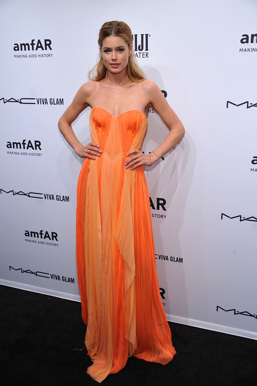 Description of . NEW YORK, NY - FEBRUARY 06:  Model/Actress Doutzen Kroes attends the amfAR New York Gala to kick off Fall 2013 Fashion Week at Cipriani Wall Street on February 6, 2013 in New York City.  (Photo by Bryan Bedder/Getty Images for FIJI Water)