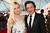 Actors Elle Fanning and John Hawkes attend the 18th Annual Critics' Choice Movie Awards held at Barker Hangar on January 10, 2013 in Santa Monica, California.  (Photo by Christopher Polk/Getty Images for BFCA)