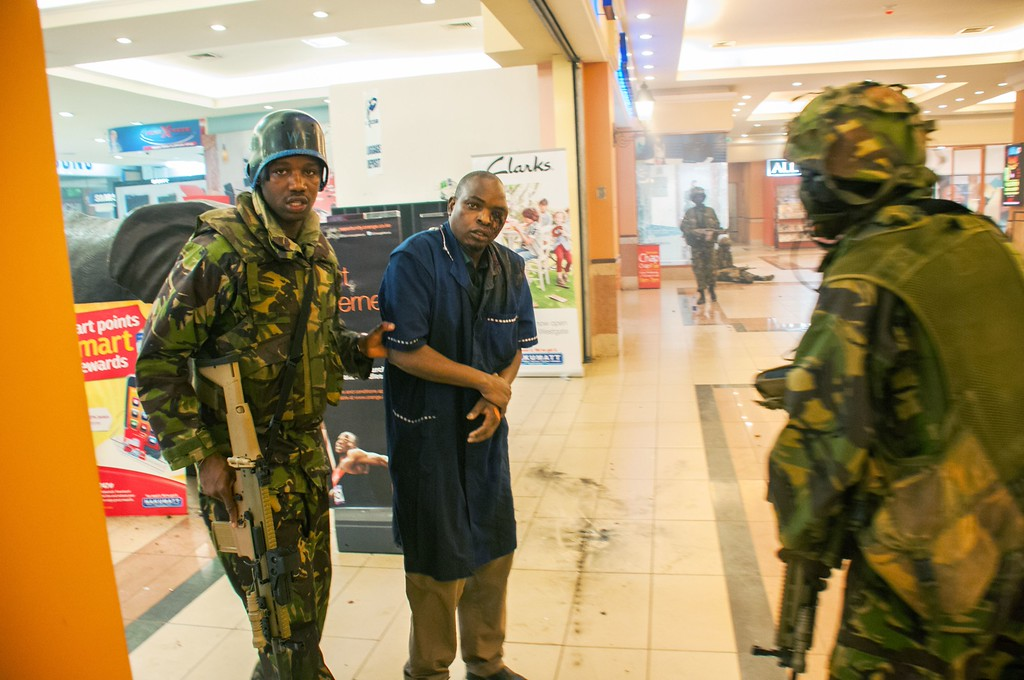 Description of . A severely wounded man is rescued by Kenyan troops at the Westgate Mall on September 21, 2013 in Nairobi.      AFP PHOTO JAMES QUEST AFP/Getty Images