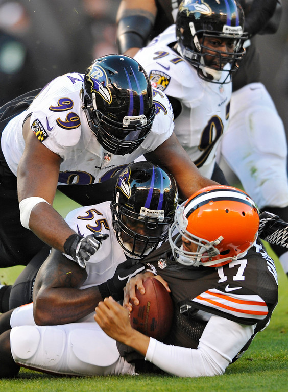 . Baltimore Ravens defensive end Chris Canty (99) and outside linebacker Terrell Suggs (55) sack Cleveland Browns quarterback Jason Campbell in the first quarter of an NFL football game Sunday, Nov. 3, 2013. (AP Photo/David Richard)