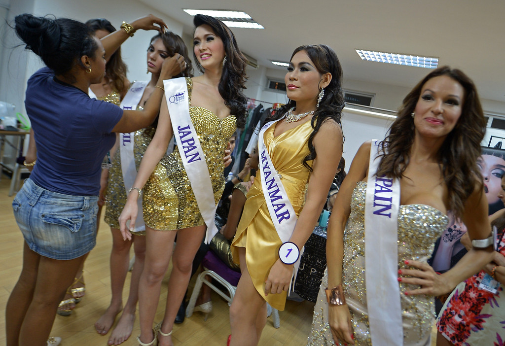 Description of . Contestants get decorate her hair at backstage during the Miss International Queen 2013 beauty contest in Pattaya resort on November 1, 2013. Twenty-five contestants from 17 countries are to compete in Pattaya for the crown of Miss International Queen since 2004. AFP PHOTO / PORNCHAI KITTIWONGSAKUL/AFP/Getty Images