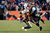 Denver Broncos cornerback Champ Bailey (24) takes down Baltimore Ravens wide receiver Torrey Smith (82) during the second half.  The Denver Broncos vs Baltimore Ravens AFC Divisional playoff game at Sports Authority Field Saturday January 12, 2013. (Photo by Hyoung Chang,/The Denver Post)