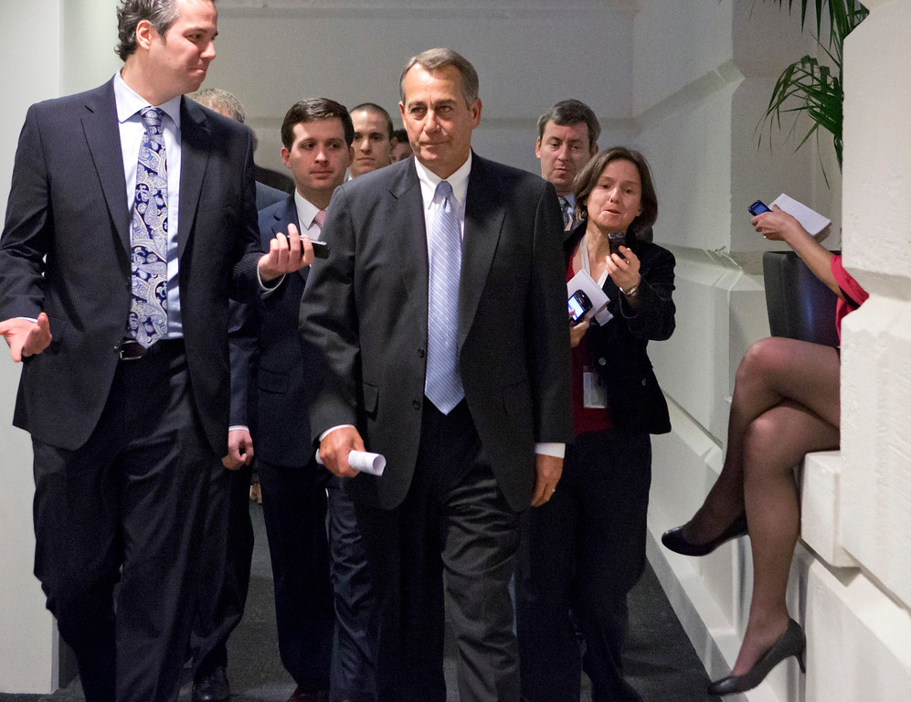 "Description of . Reporters pursue Speaker of the House John Boehner, R-Ohio, as he walks to a closed-door meeting with GOP members of the House as Congress in Washington, Monday, Dec. 31, 2012, as Senate and House leaders rush to assemble a last-ditch agreement to head off the automatic tax hikes and spending cuts set to take effect Jan. 1, 2013. The House will miss the midnight Monday deadline lawmakers set for voting to avoid the ""fiscal cliff.\""  (AP Photo/J. Scott Applewhite)"