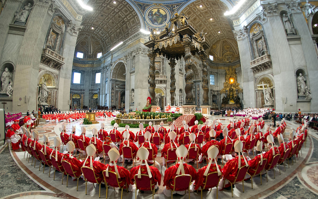 Description of . In this photo provided by the Vatican newspaper L\'Osservatore Romano, cardinals, in red, attend a Mass for the election of a new pope celebrated by Cardinal Angelo Sodano inside St. Peter\'s Basilica, at the Vatican, Tuesday, March 12, 2013. (AP Photo/L\'Osservatore Romano, ho)