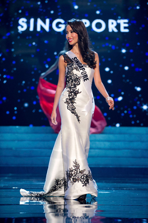 Description of . Miss Singapore 2012 Lynn Tan competes in an evening gown of her choice during the Evening Gown Competition of the 2012 Miss Universe Presentation Show in Las Vegas, Nevada, December 13, 2012. The Miss Universe 2012 pageant will be held on December 19 at the Planet Hollywood Resort and Casino in Las Vegas. REUTERS/Darren Decker/Miss Universe Organization L.P/Handout