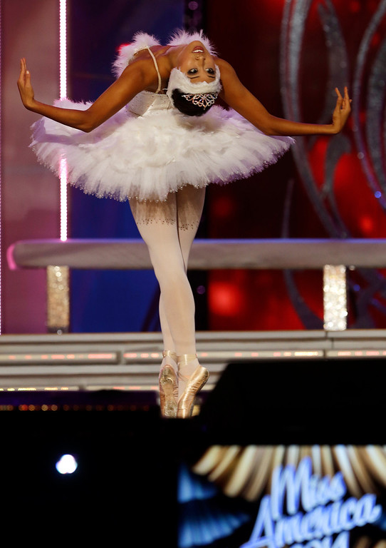 Description of . Miss California Crystal Lee performs during the Miss America 2014 pageant, Sunday, Sept. 15, 2013, in Atlantic City, N.J. (AP Photo/Mel Evans)
