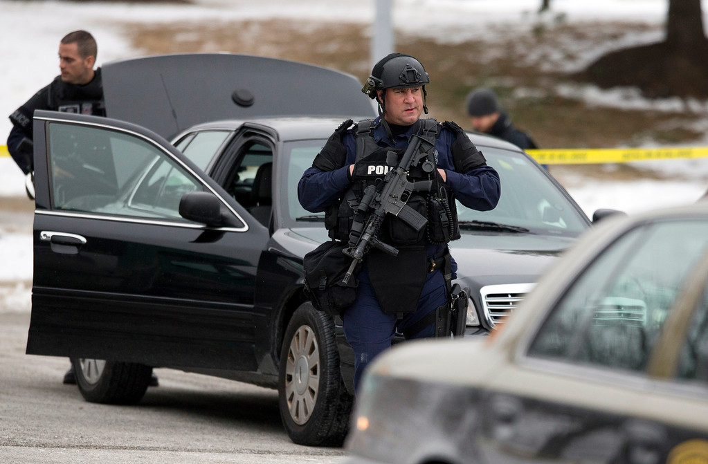 Description of . Police walk on the scene after a shooting at The Mall in Columbia on Saturday, Jan. 25, 2014 in Columbia, Md. Police say three people died in a shooting at the mall in suburban Baltimore, including the presumed gunman.(AP Photo/ Evan Vucci)
