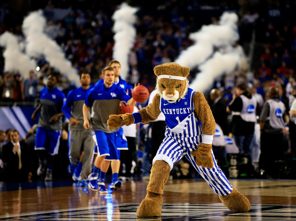 Description of . ARLINGTON, TX - APRIL 07:  The Kentucky Wildcats mascot performs before the NCAA Men\'s Final Four Championship against the Connecticut Huskies at AT&T Stadium on April 7, 2014 in Arlington, Texas.  (Photo by Jamie Squire/Getty Images)