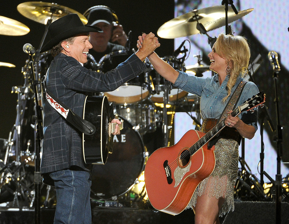 Description of . George Strait, left, and Miranda Lambert perform on stage at the 49th annual Academy of Country Music Awards at the MGM Grand Garden Arena on Sunday, April 6, 2014, in Las Vegas. (Photo by Chris Pizzello/Invision/AP)