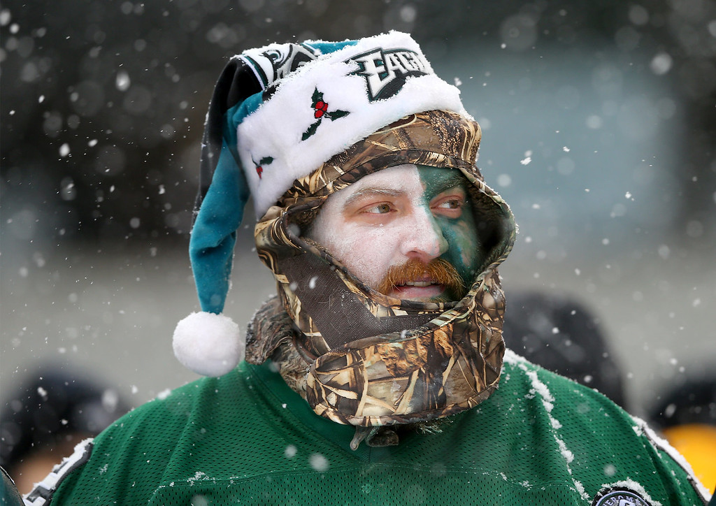 Description of . A Philadelphia Eagles fan watches the game in the third quarter against the Detroit Lions on December 8, 2013 at Lincoln Financial Field in Philadelphia, Pennslyvania.  (Photo by Elsa/Getty Images)