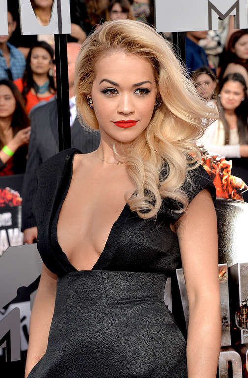 Description of . Singer Rita Ora attends the 2014 MTV Movie Awards at Nokia Theatre L.A. Live on April 13, 2014 in Los Angeles, California.  (Photo by Michael Buckner/Getty Images)