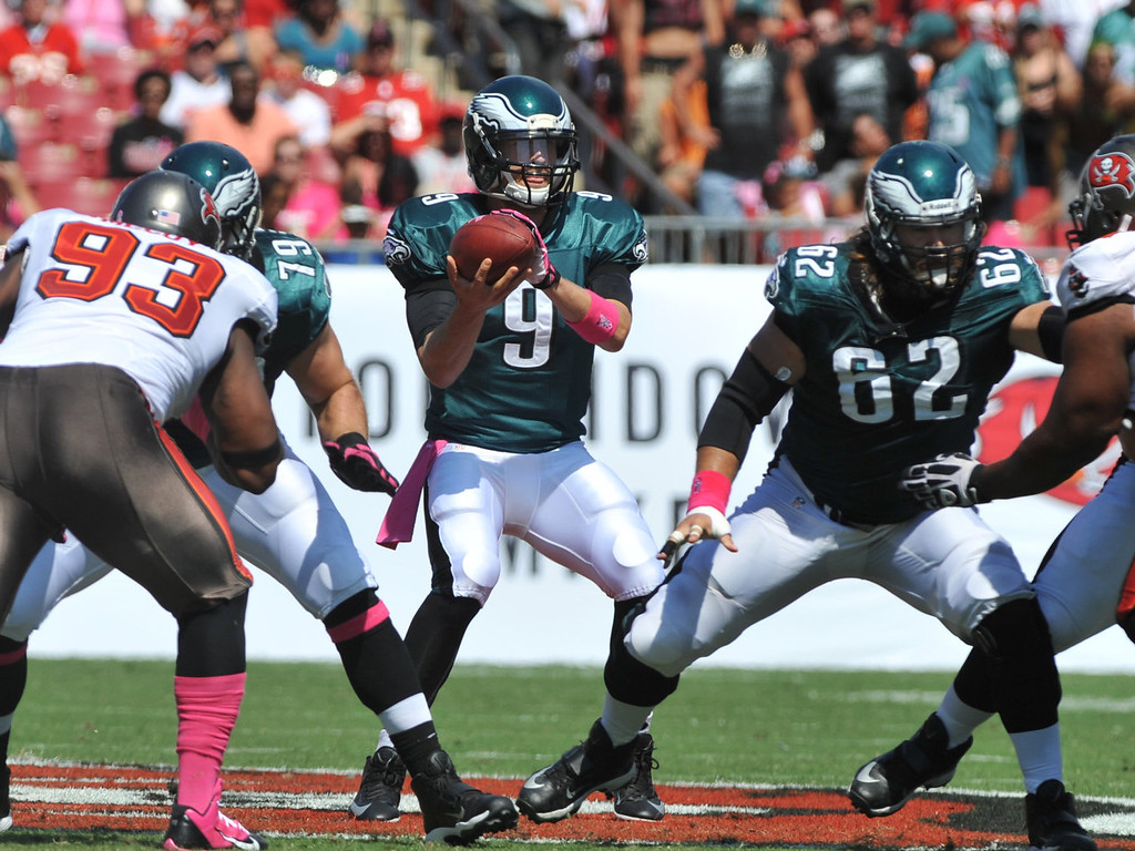 Description of . Quarterback Nick Foles #9 of the Philadelphia Eagles takes a snap in the1st quarter against the Tampa Bay Buccaneers October 13, 2013 at Raymond James Stadium in Tampa, Florida. (Photo by Al Messerschmidt/Getty Images)