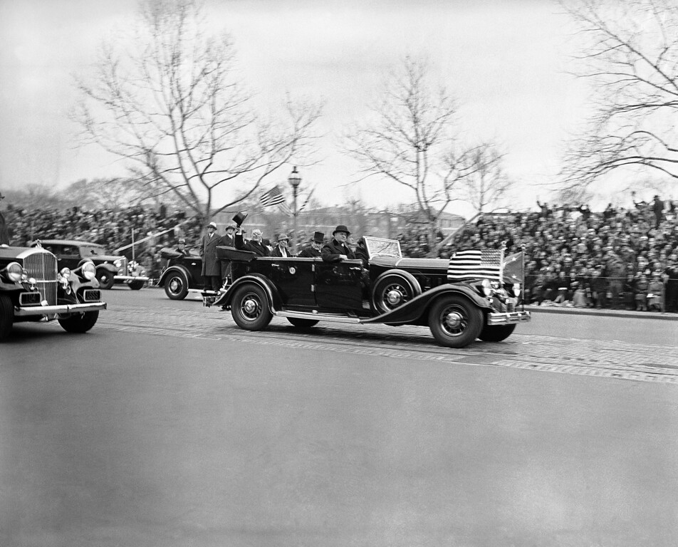 Description of . President-elect Franklin D. Roosevelt rides in a limousine on his inauguration day in 1933. (Photo from The Library of Congress)