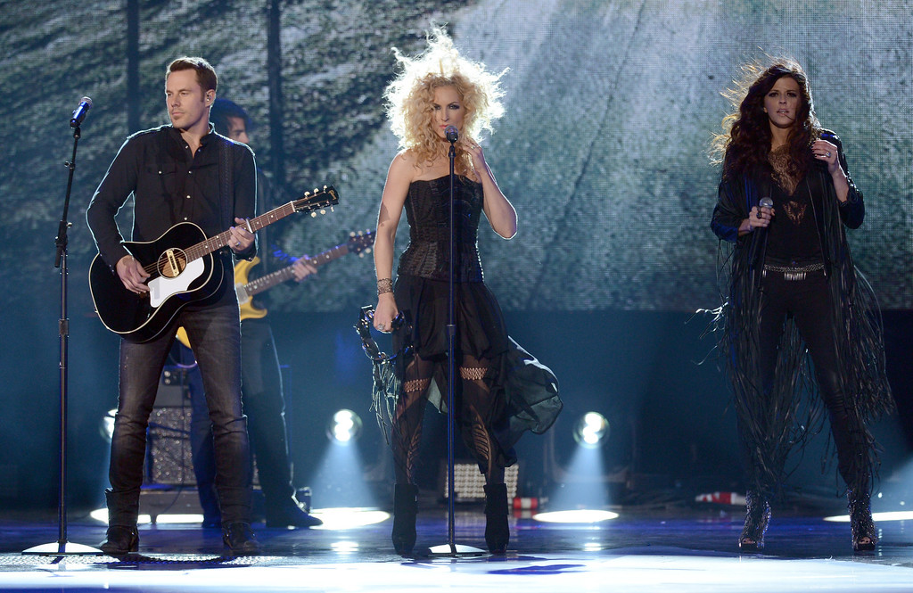 Description of . LAS VEGAS, NV - DECEMBER 10:  Jimi Westbrook, Kimberly Schlapman, and Karen Fairchild of Little Big Town perform onstage during the 2012 American Country Awards at the Mandalay Bay Events Center on December 10, 2012 in Las Vegas, Nevada.  (Photo by Mark Davis/Getty Images)