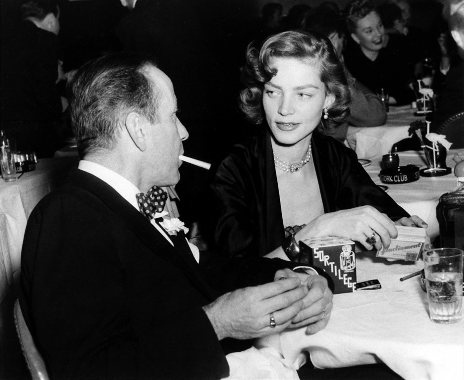 . FILE - This Feb. 1950 file photo shows actor Humphrey Bogart, left, and his wife actress Lauren Bacall appear at the Stork Club in New York. Bacall, the sultry-voiced actress and Humphrey Bogart�s partner off and on the screen, died Tuesday, Aug. 12, 2014 in New York. She was 89. (AP Photo, File)