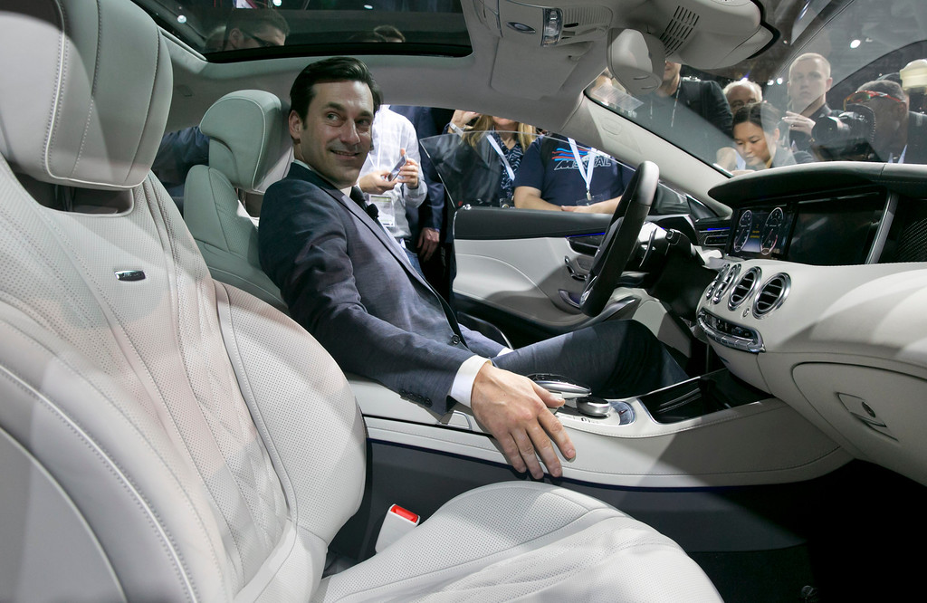 """. Actor Jon Hamm, of television\'s \""""Mad Men,\"""" sits in the 2015 Mercedes Benz S63 AMG Coupe, during its introduction at the 2014 New York International Auto Show at the Javits Convention Center, Wednesday, April 16, 2014, in New York.  (AP Photo/Richard Drew)"""