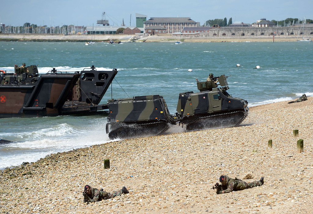 Description of . British and Dutch Marines demonstrate a beach landing during a beach landing demonstration during D-Day commemorations in Portsmouth in southern England on June 5, 2014. AFP PHOTO / CARL COURT/AFP/Getty Images