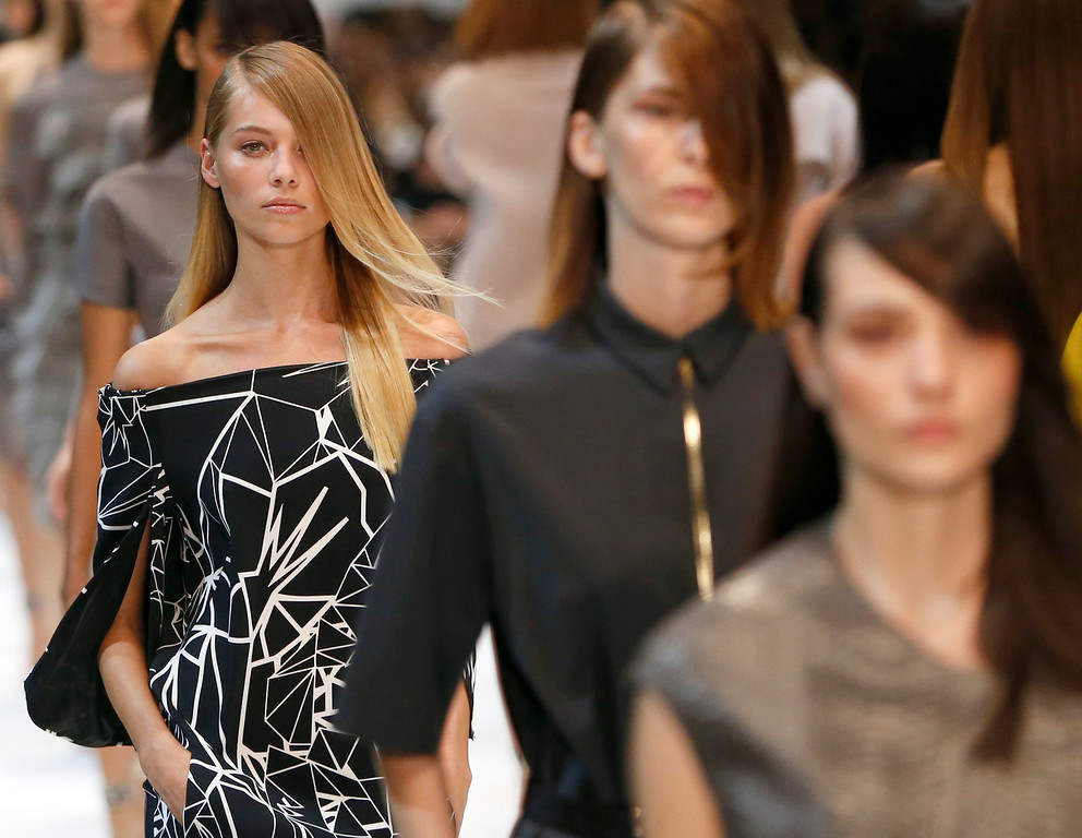 Description of . A model wears a creation for Guy Laroche's ready-to-wear Spring/Summer 2014 fashion collection, in Paris, Wednesday, Sept.25, 2013. (AP Photo/Jacques Brinon)