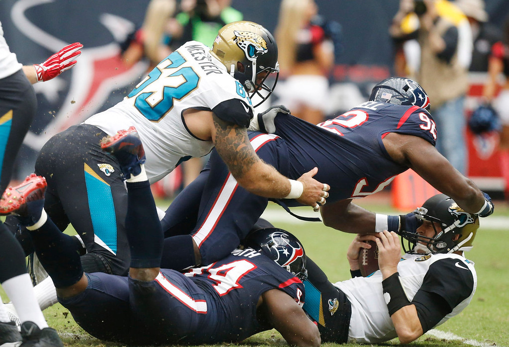 Description of . Jacksonville Jaguars quarterback Chad Henne gets sacked by Houston Texans nose tackle Earl Mitchell (92) during the first quarter an NFL football game Sunday, Nov. 24, 2013, in Houston. (AP Photo/Patric Schneider)