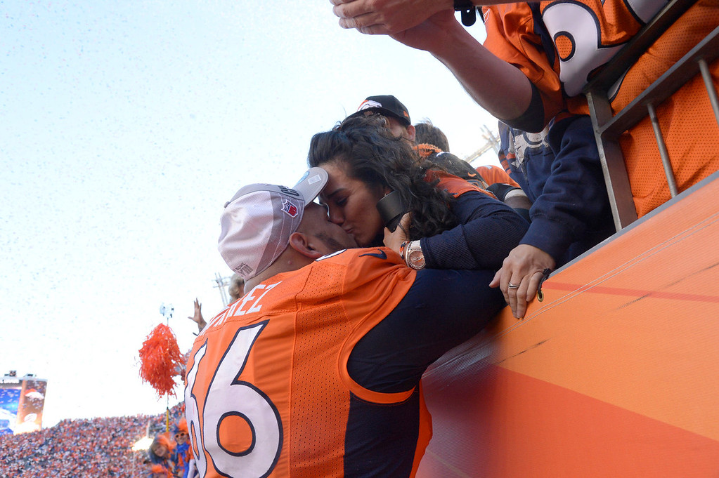 Description of . Denver Broncos center Manny Ramirez (66) gets a kiss from his wife after the Denver Broncos beat the New England Patriots 26-16. The Denver Broncos vs. The New England Patriots in an AFC Championship game  at Sports Authority Field at Mile High in Denver on January 19, 2014. (Photo by Joe Amon/The Denver Post)