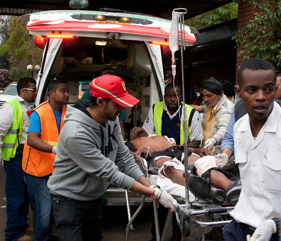 Description of . An injured person arrives in an ambulance at the Aga Khan Hospital in Nairobi after an attack at the Westgate Mall, an upscale shopping mall in Nairobi, Kenya Saturday Sept. 21, 2013, where shooting erupted when armed men staged an attack. (AP Photo/Jason Straziuso)