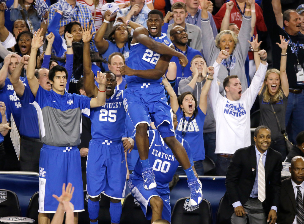 Description of . Kentucky forward Alex Poythress (22) reacts after a three-point basket during the second half of an NCAA Final Four tournament college basketball semifinal game against Wisconsin Saturday, April 5, 2014, in Arlington, Texas. Kentucky won 74-73. (AP Photo/Tony Gutierrez)