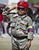 A little girl wearing a battledress salutes outside of late Venezuelan President Hugo Chavez funeral in Caracas, on March 8, 2013. AFP PHOTO/Ronaldo  Schemidt/AFP/Getty Images