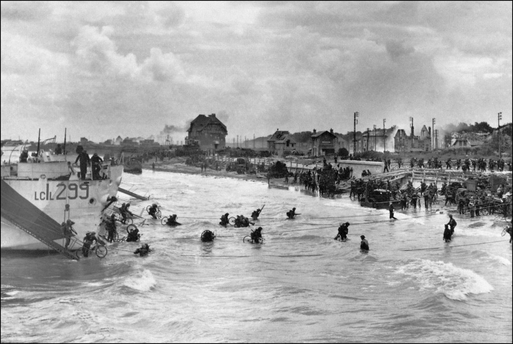 Description of . Canadian soldiers from 9th Brigade land June 6, 1944 with their bicycles at Juno Beach in Bernieres-sur-Mer during D-Day while Allied forces are storming the Normandy beaches.      (Photo credit should read STF/AFP/Getty Images)