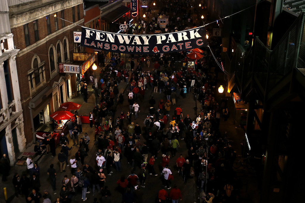 Description of . Fans stand outside Fenway Park for Game Six of the 2013 World Series between the Boston Red Sox and the St. Louis Cardinals on October 30, 2013 in Boston, Massachusetts.  (Photo by Jim Rogash/Getty Images)