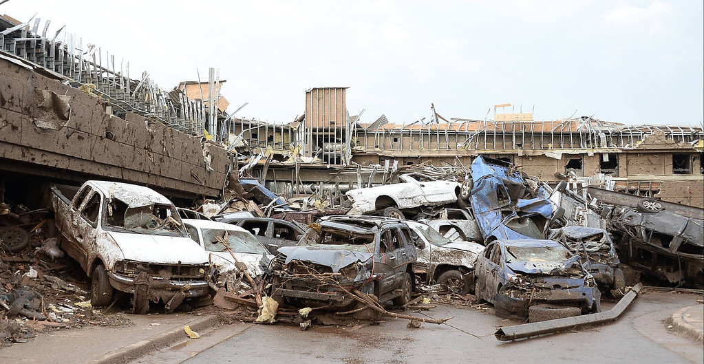 . Dozen of cars  piled up on top of each other in the parking lot of Moore Hospital after a tornado struck Moore, Oklahoma, May 20, 2013.  A huge tornado with winds of up to 200 miles per hour (320 kph) devastated the Oklahoma City suburb of Moore on Monday, ripping up at least two elementary schools and a hospital and leaving a wake of tangled wreckage. REUTERS/Gene Blevins
