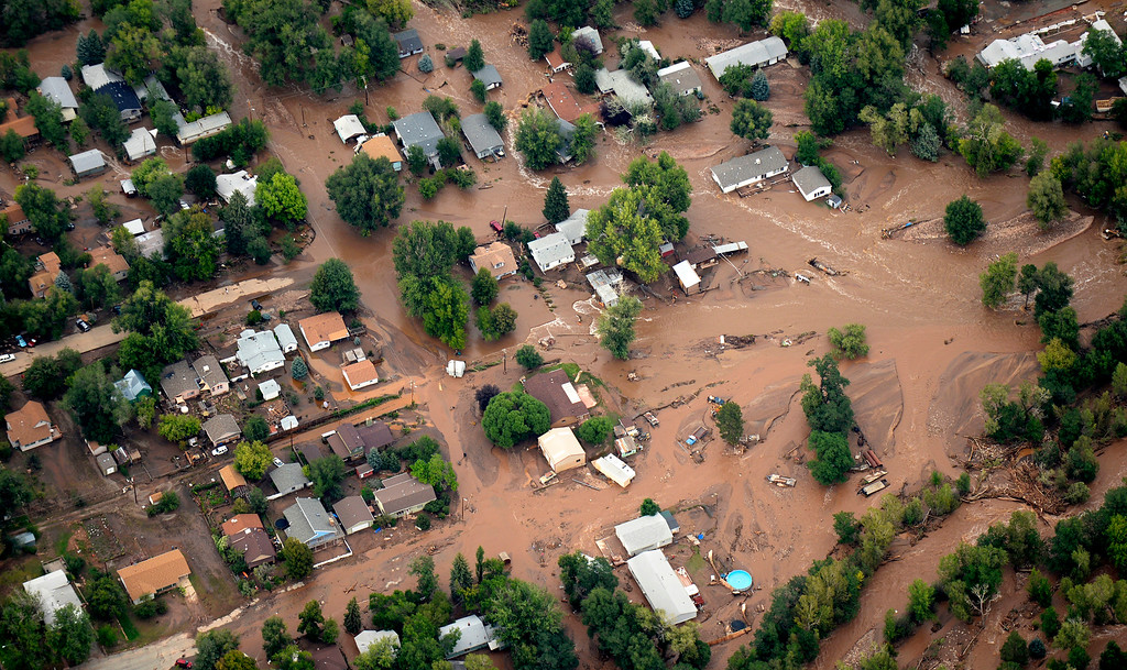 Description of . The town of Lyons is flooded by the North and South Vrain Creeks on September 13, 2013. Rescuers in Lyons were scrambling to evacuate residents because the only bridge into the town was beginning to crumble.