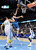 Minnesota Timberwolves guard Ricky Rubio, center, drives to the basket past Denver Nuggets center JaVale McGee, left, and forward Corey Brewer, right, in the first quarter of an NBA basketball game on Saturday, March 9, 2013, in Denver.  (AP Photo/Chris Schneider)