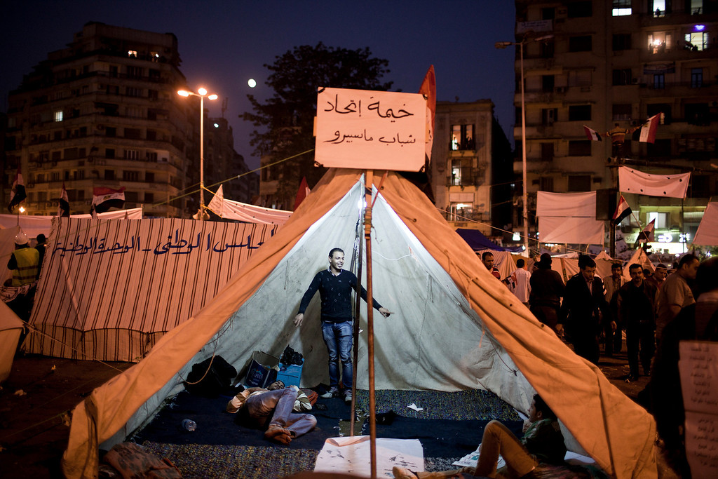 Description of . Protesters in a tent in Cairo's Tahrir Square, Nov. 27, 2012. Demonstrators began flowing into the streets of Cairo Tuesday for a day of protest against President Mohammed Morsi's effort to assert broad new powers, dismissing his efforts only hours before to reaffirm his deference to Egyptian law and courts. (Ivor Prickett/The New York Times)