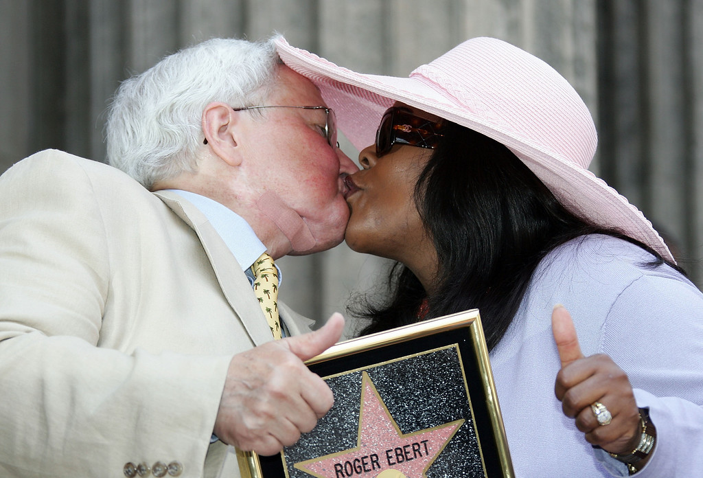Description of . Movie Critic Roger Ebert and his wife, Chaz Ebert, kiss as he receives the 2,288th Star on the Hollywood Walk of Fame June 23, 2005 in Hollywood, California.  (Photo by Frazer Harrison/Getty Images)