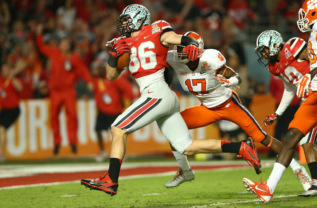 Description of . MIAMI GARDENS, FL - JANUARY 03:  Jeff Heuerman #86 of the Ohio State Buckeyes runs for a touchdown after a catch against Bashaud Breeland #17 of Clemson Tigers in the second quarter during the Discover Orange Bowl at Sun Life Stadium on January 3, 2014 in Miami Gardens, Florida.  (Photo by Streeter Lecka/Getty Images)