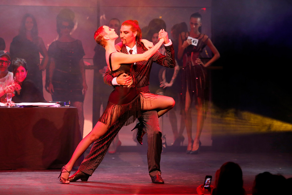Description of . Models performs a tango dance while presenting creations as part of Jean-Paul Gaultier's ready-to-wear Spring/Summer 2014 fashion collection, presented Saturday, Sept. 28, 2013 in Paris. (AP Photo/Jacques Brinon)