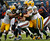 Chicago Bears running back Matt Forte (22) sandwiched by Green Bay Packers linebackers Brad Jones (59) and Clay Matthews (52) and defensive tackle Mike Neal (96) in the first half of an NFL football game in Chicago, Sunday, Dec. 16, 2012. (AP Photo/Charles Rex Arbogast)