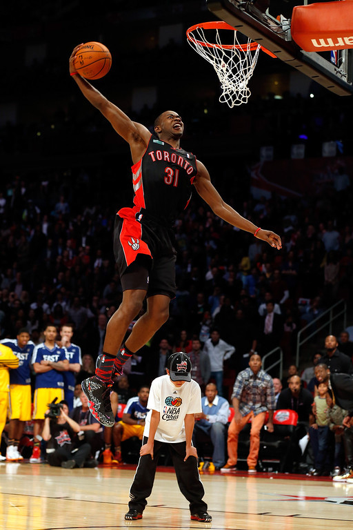 Description of . HOUSTON, TX - FEBRUARY 16:  Terrence Ross of the Toronto Raptors jumps over a ball kid in his final dunk during the Sprite Slam Dunk Contest part of 2013 NBA All-Star Weekend at the Toyota Center on February 16, 2013 in Houston, Texas.  (Photo by Scott Halleran/Getty Images)