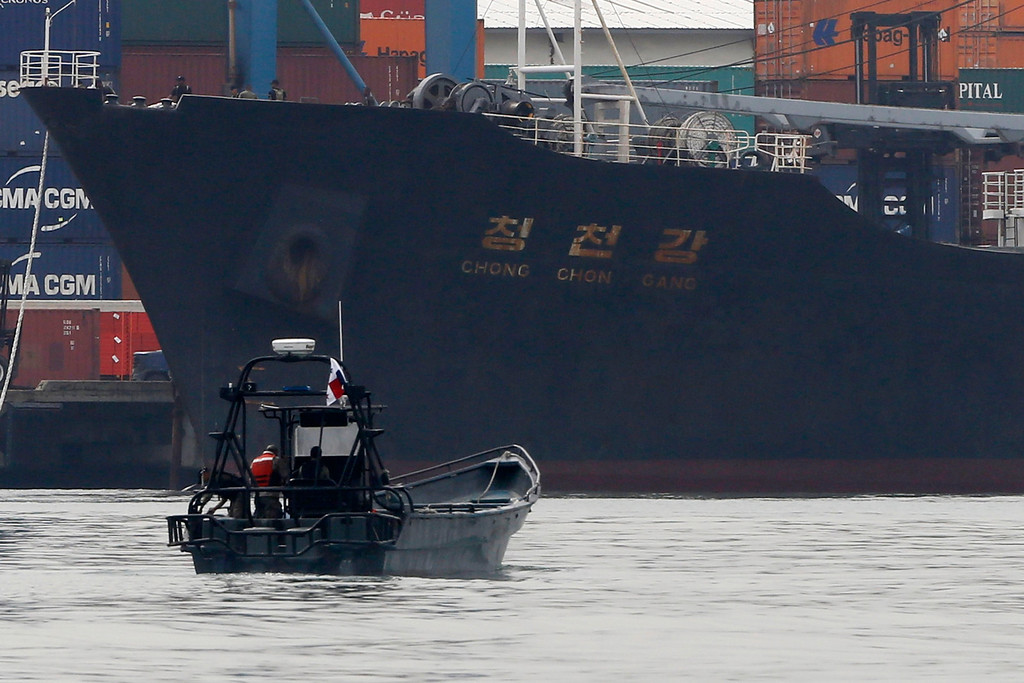 Description of . North Korean container ship ''Chong Chon Gang'' docks at the Manzanillo International Container Terminal in Colon City July 16, 2013. Panama detained the North Korean-flagged ship from Cuba as it headed to the Panama Canal and said it was hiding weapons in brown sugar containers, sparking a standoff in which the ship's captain attempted to commit suicide. REUTERS/Carlos Jasso
