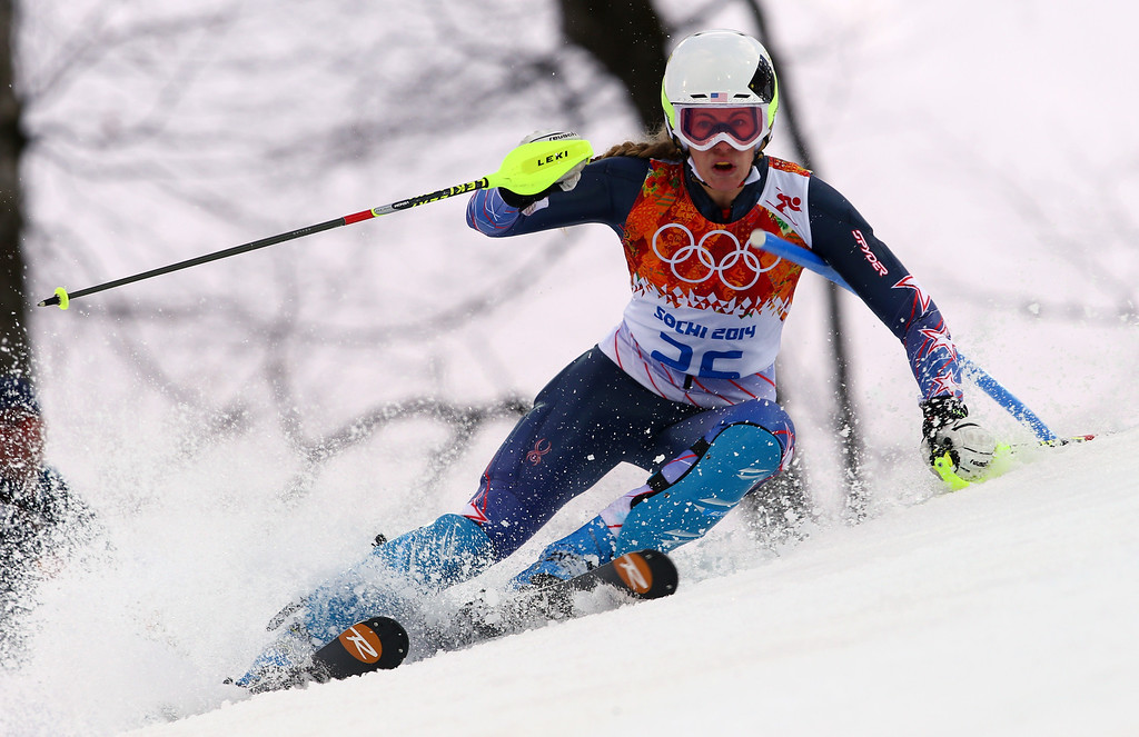 Description of . United States' Resi Stiegler skis past a gate in the first run of the women's slalom at the Sochi 2014 Winter Olympics, Friday, Feb. 21, 2014, in Krasnaya Polyana, Russia.  (AP Photo/Alessandro Trovati)