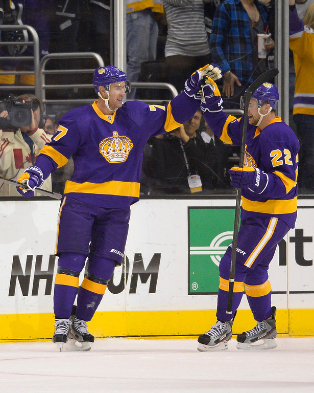Description of . Los Angeles Kings center Jeff Carter, left, celebrates his goal with center Trevor Lewis during the first period of their NHL hockey game against the Colorado Avalanche, Saturday, Feb. 23, 2013, in Los Angeles. (AP Photo/Mark J. Terrill)