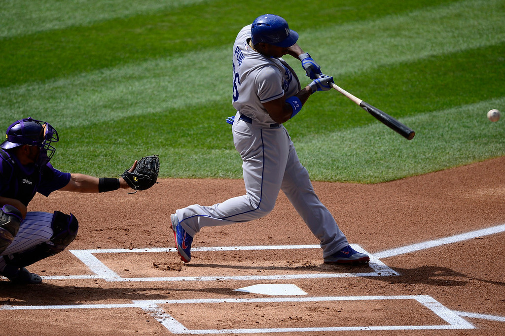 Description of . Yasiel Puig (66) of the Los Angeles Dodgers rips a base hit off of Chad Bettis (35) of the Colorado Rockies during the action in Denver on Monday, September 2, 2013. The Colorado Rockies hosted the Los Angeles Dodgers at Coors Field.   (Photo by AAron Ontiveroz/The Denver Post)
