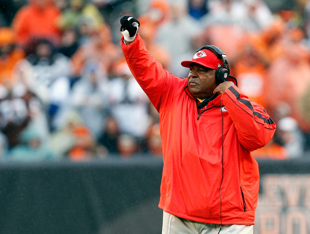 . CLEVELAND, OH - DECEMBER 09:  Head coach Romeo Crennal of the Kansas City Chiefs calls a play against the Cleveland Browns at Cleveland Browns Stadium on December 9, 2012 in Cleveland, Ohio.  (Photo by Matt Sullivan/Getty Images)