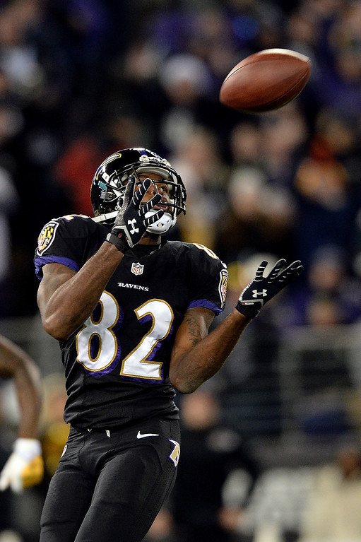 Description of . Torrey Smith #82 of the Baltimore Ravens catches a 54-yard pass from quarterback Joe Flacco #5 (not pictured) in the first quarter of an NFL game against the Pittsburgh Steelers at M&T Bank Stadium on November 28, 2013 in Baltimore, Maryland.  (Photo by Patrick Smith/Getty Images)