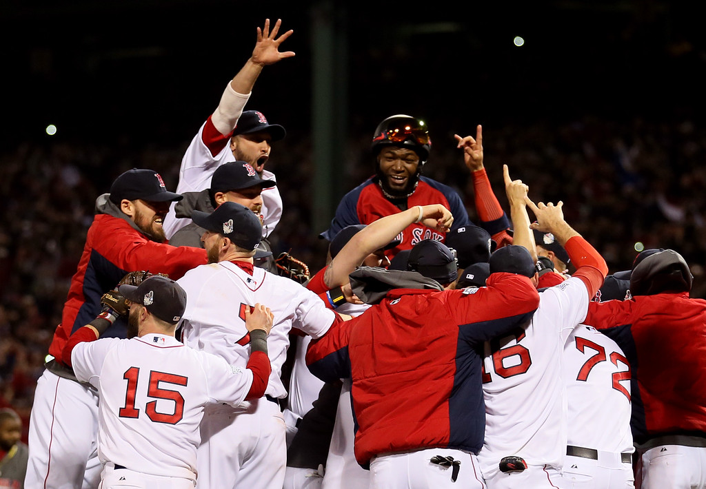 Description of . The Boston Red Sox celebrate after defeating the St. Louis Cardinals in Game Six of the 2013 World Series at Fenway Park on October 30, 2013 in Boston, Massachusetts. The Boston Red Sox defeated the St. Louis Cardinals 6-1.  (Photo by Rob Carr/Getty Images)