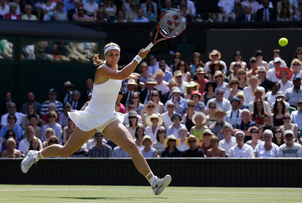 Description of . Sabine Lisicki of Germany returns to Marion Bartoli of France during their Women's singles final match at the All England Lawn Tennis Championships in Wimbledon, London, Saturday, July 6, 2013. (AP Photo/Anja Niedringhaus)