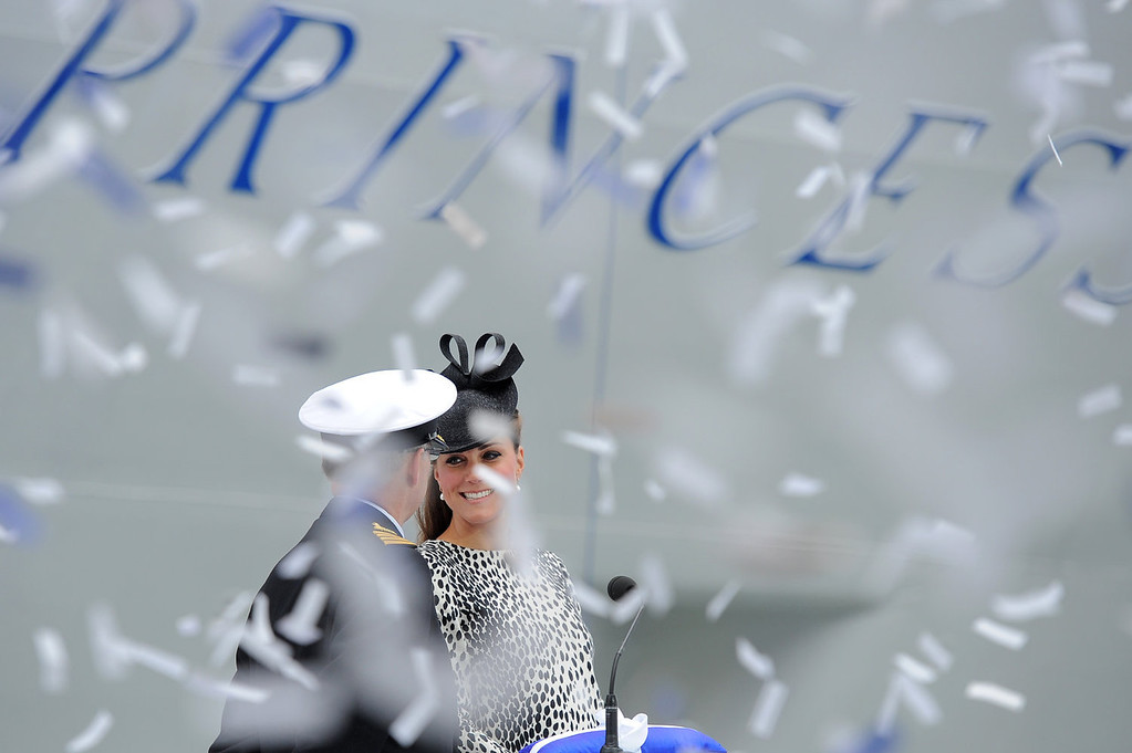 Description of . Ticker tape falls as Britain\'s Catherine, Duchess of Cambridge (R) officially names Princess Cruises\'s new ship \'Royal Princess\' in Southampton, southern England on June 13, 2013. The Duchess of Cambridge, as the ship\'s godmother, officially named the Royal Princess with a traditional blessing involving smashing a bottle over the ship\'s hull in what is expected to her final solo engagement before the birth of her and Prince William\'s child.  BEN STANSALL/AFP/Getty Images