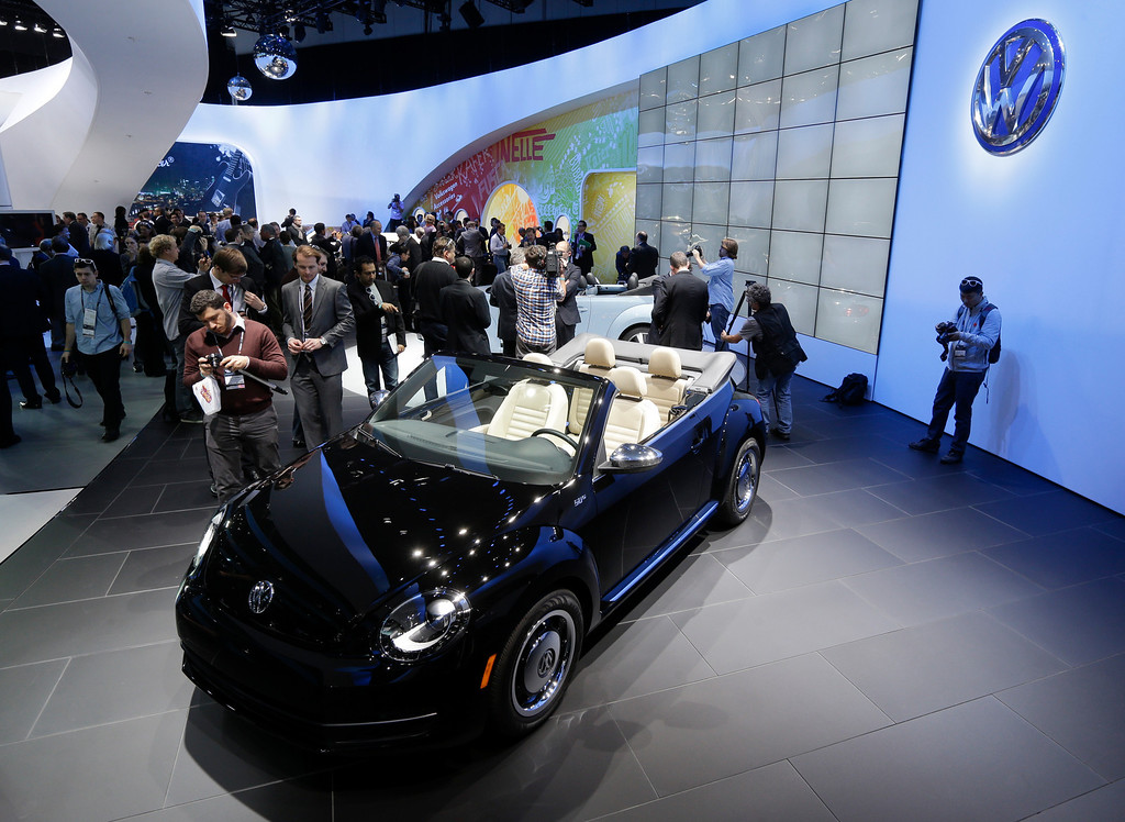 Description of . Volkswagen Beetle convertible is shown during it's world debut at the LA Auto Show in Los Angeles, Wednesday, Nov. 28, 2012. The annual Los Angeles Auto Show opened to the media Wednesday at the Los Angeles Convention Center. The show opens to the public on Friday, November 30. (AP Photo/Chris Carlson)