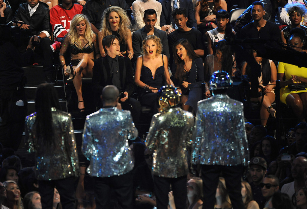 Description of . Taylor Swift, seated center, reacts after it was announced she won the award for best female video to Taylor Swift for