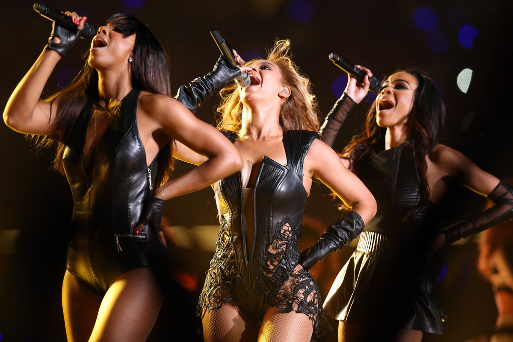 Description of . Kelly Rowland, Beyonce Knowles and Michelle Williams of Destinys Child perform during the Pepsi Super Bowl XLVII Halftime Show at Mercedes-Benz Superdome on February 3, 2013 in New Orleans, Louisiana.  (Photo by Christopher Polk/Getty Images)